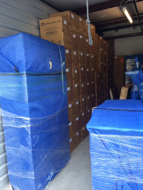 Inside of truck (boxes and furniture wrapped in blue blankets)
